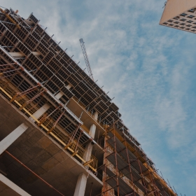 Building construction site with scaffolding